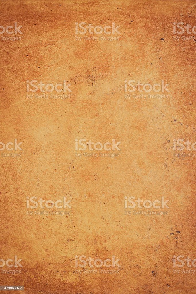 Ocher stone wall stock photo