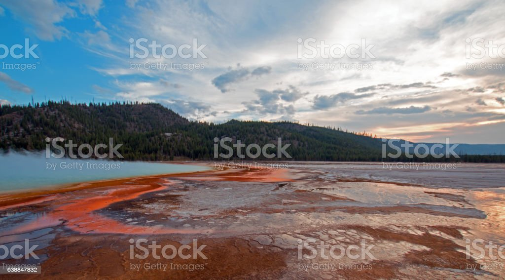 Ocher streaks of Grand Prismatic Spring at sunset Yellowstone NP stock photo