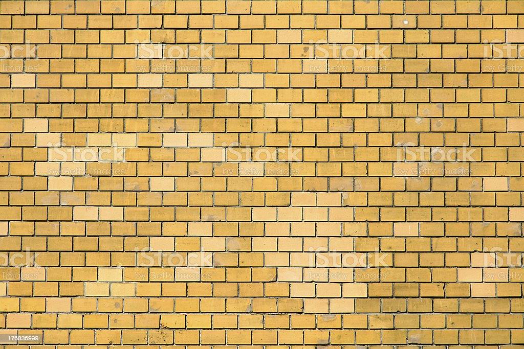 Ochre brick wall stock photo