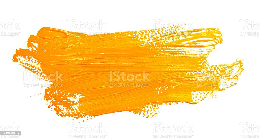 Ochre stroke of the paint brush isolated stock photo