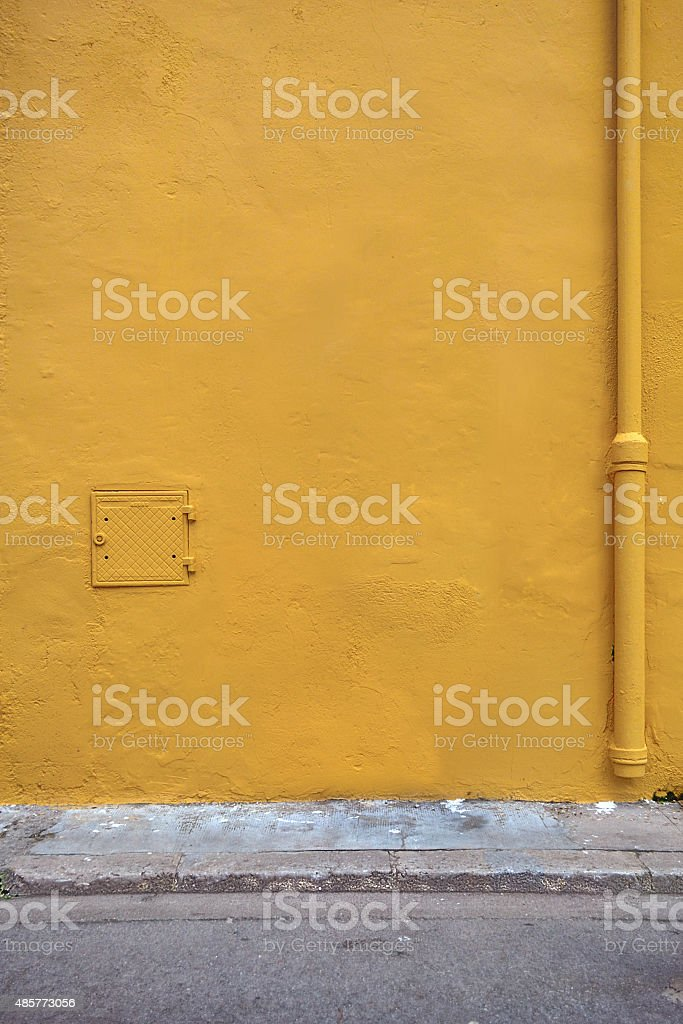 Ochre wall texture background stock photo