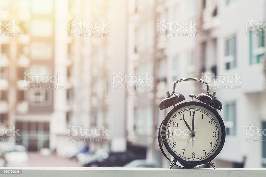 11 o'clock retro clock with The Clock condominium background. stock photo