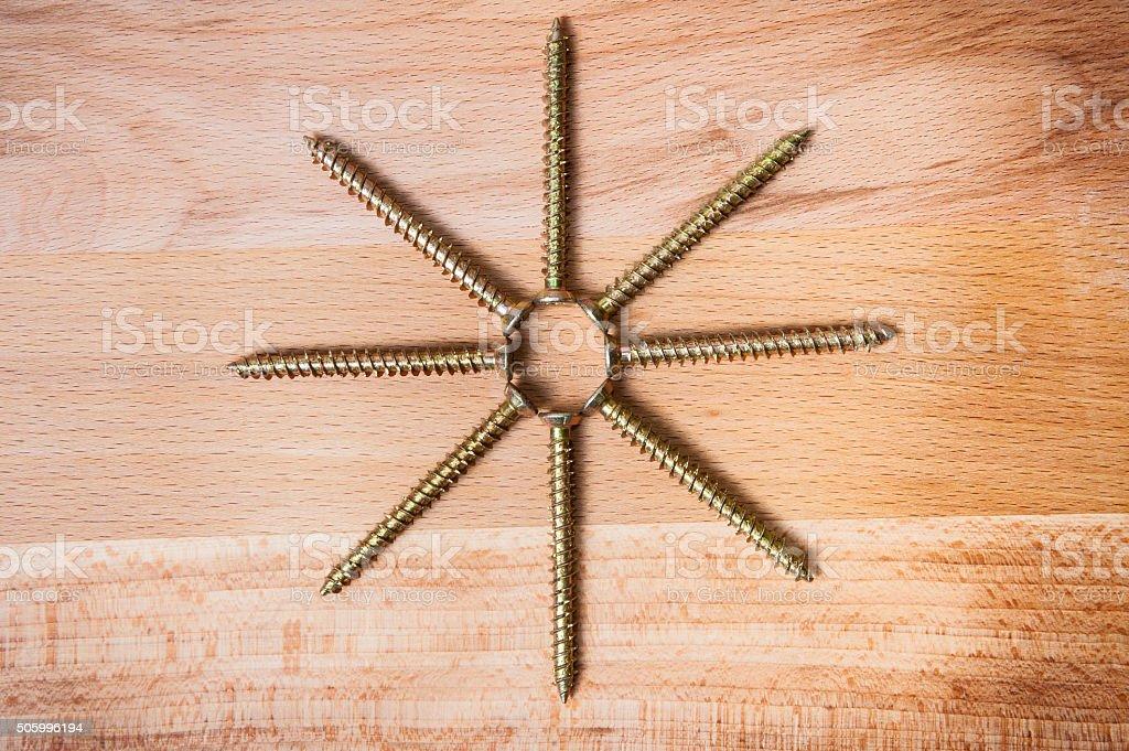 Octactinal star from screws stock photo