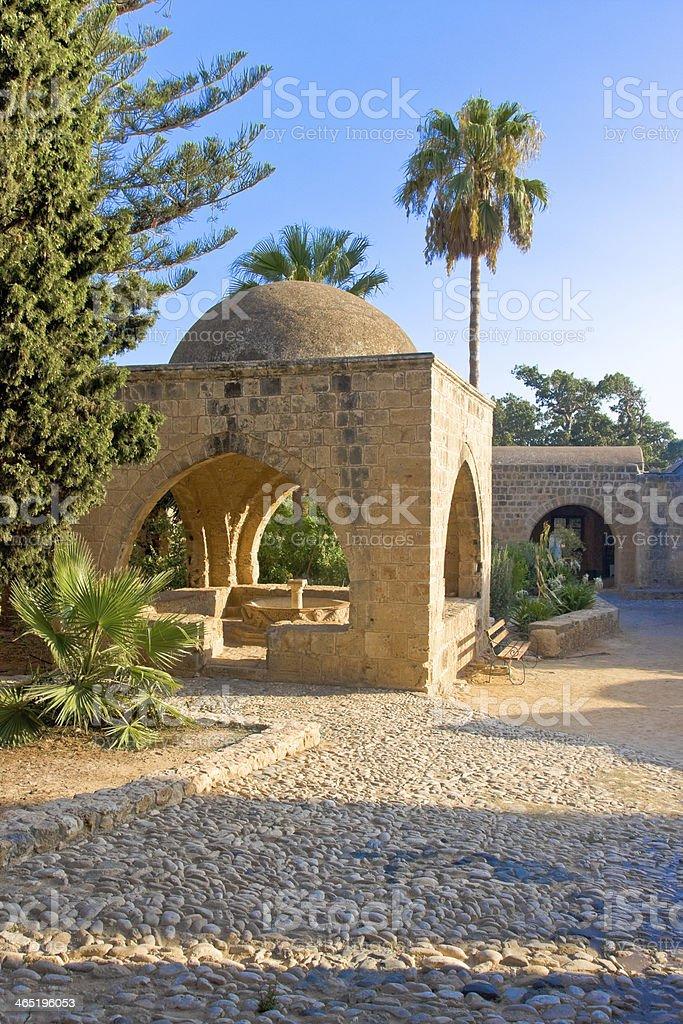 Octagonal fountain in courtyard of monastery. Ayia Napa, Cyprus royalty-free stock photo