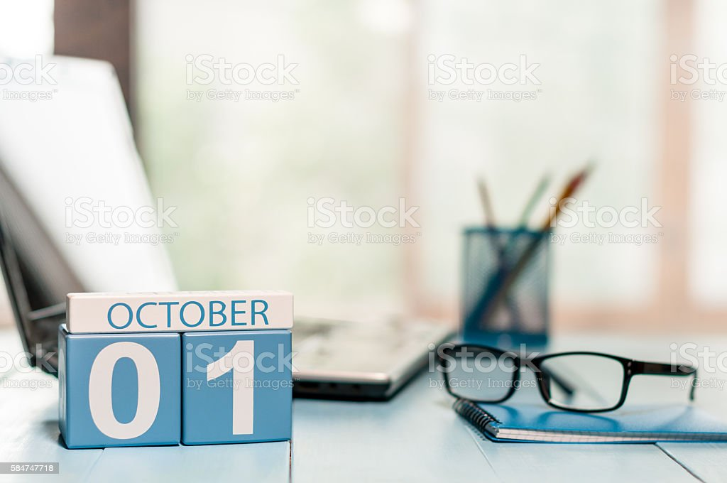 October 1st. Day 1 of month, calendar on teacher workplace stock photo
