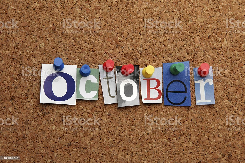 October pinned on noticeboard stock photo