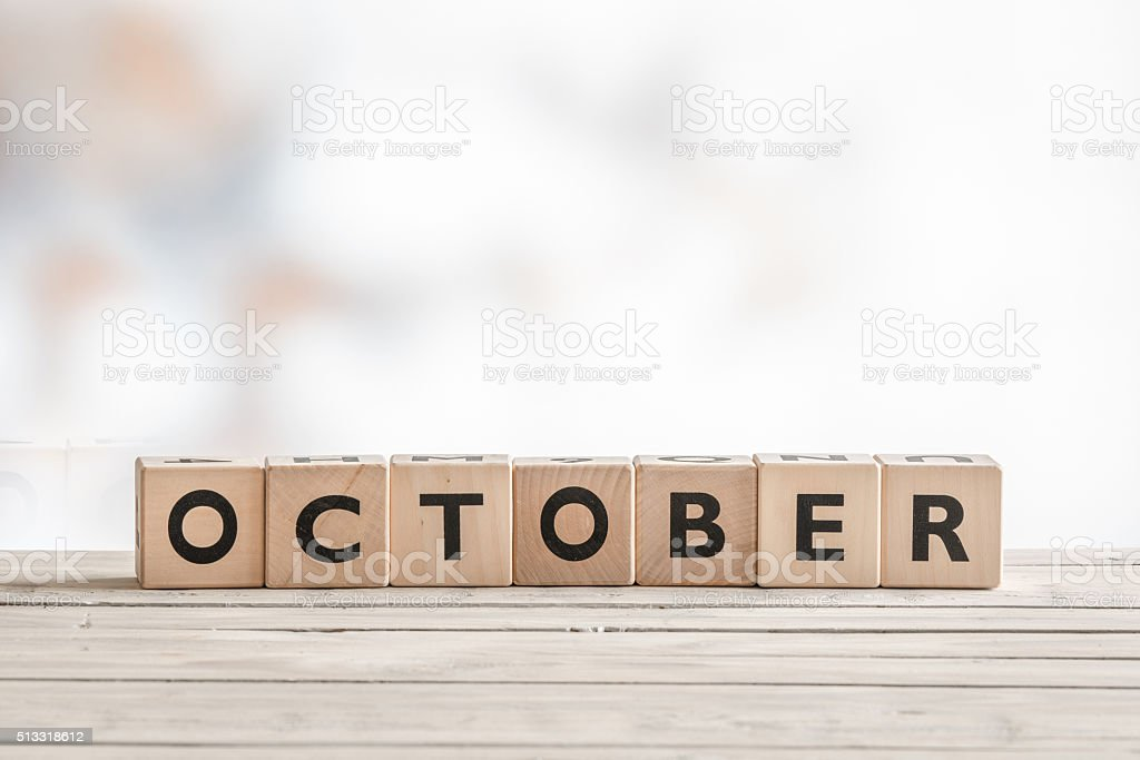 October sign made of wooden cubes stock photo