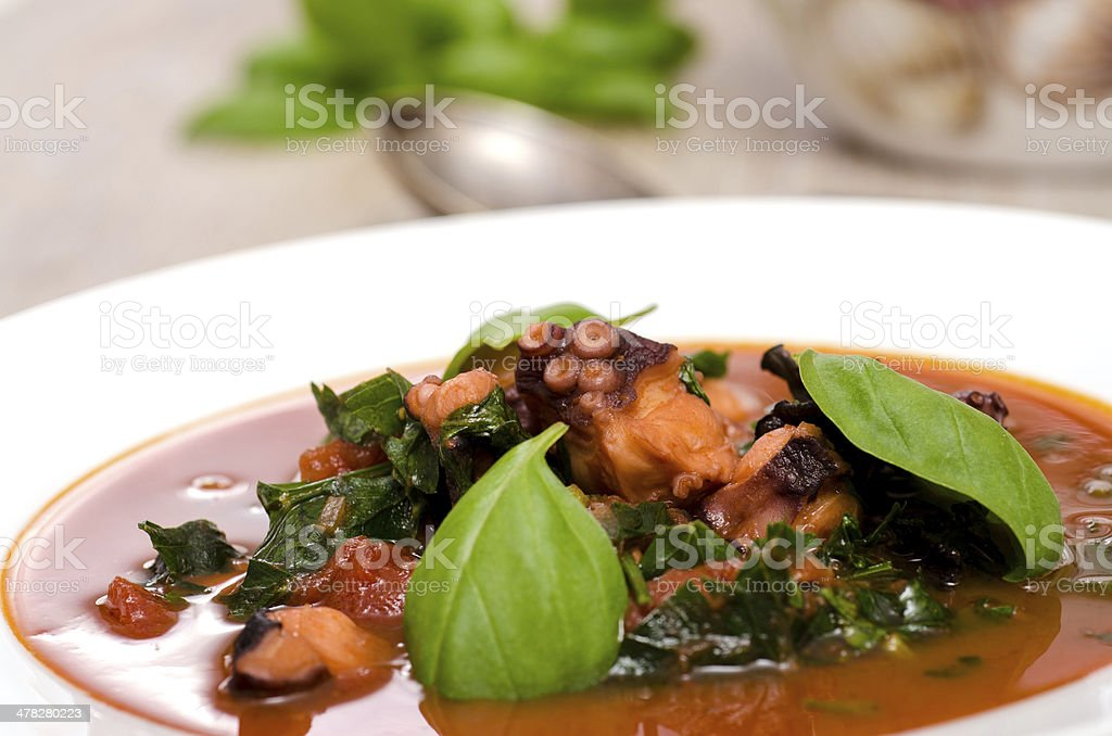 Octopus and basil with tomato sauce royalty-free stock photo
