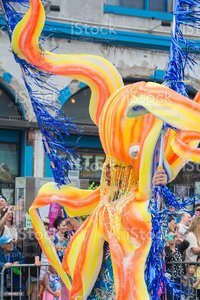 Octopus man at mermaid parade in coney island stock photo