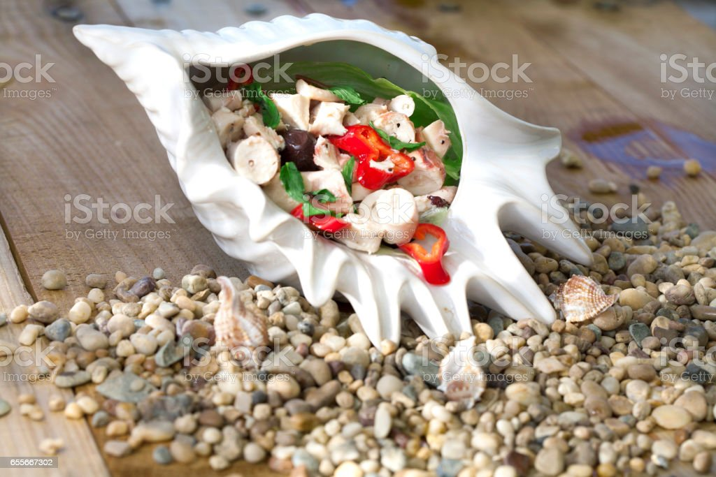 Octopus salad with vegetables, Mediteranean cuisine stock photo