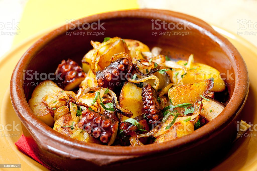 Octopus with fried potatoes stock photo