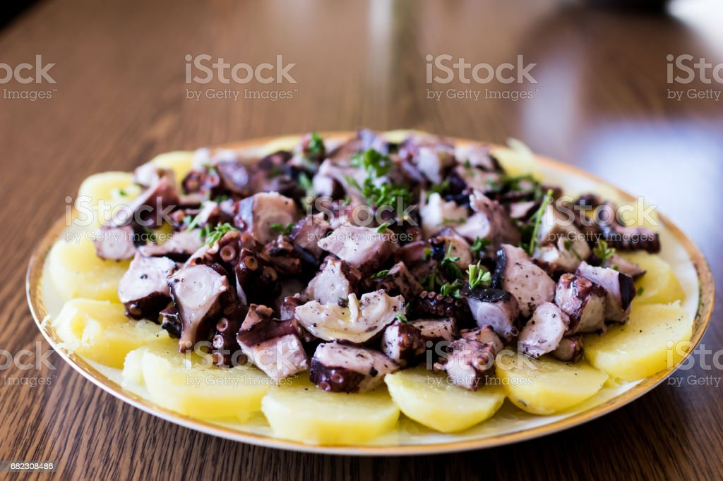 Octopus with potatoes. stock photo