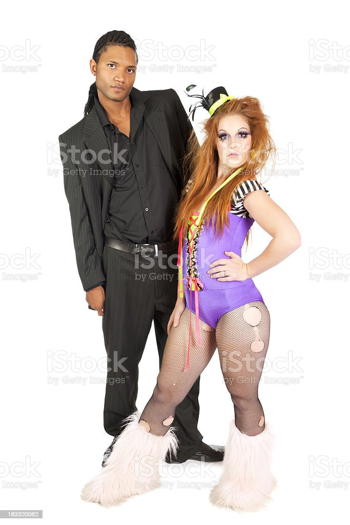 Odd couple: young woman in clown outfit and stylish man royalty-free stock photo