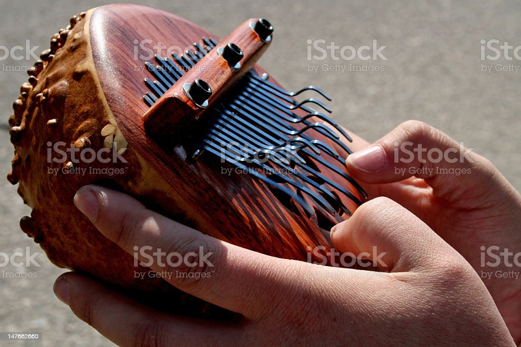 Odd musical instrument with two hands playing it  stock photo