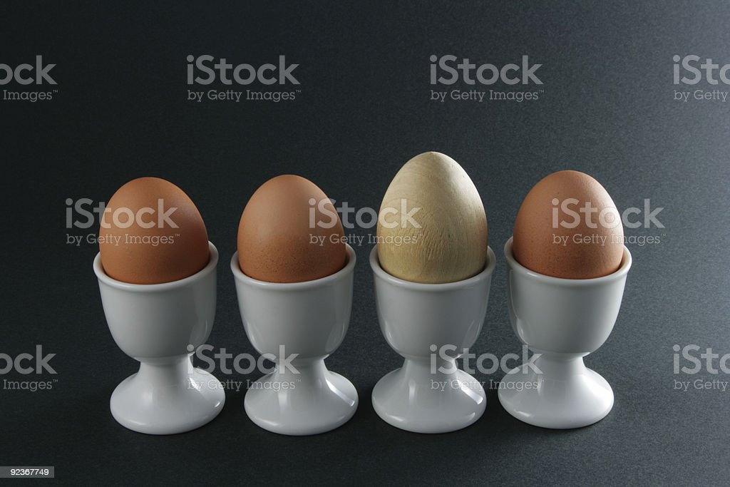 Odd One Out - Wooden Egg stock photo