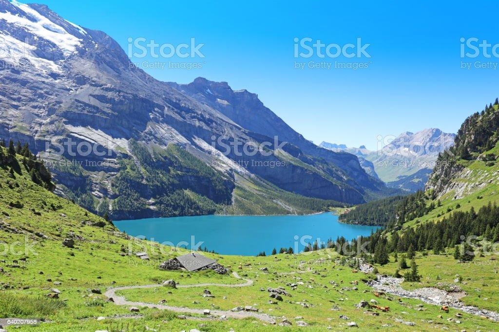 Oeschinensee Mountain Lake in Central Switzerland stock photo