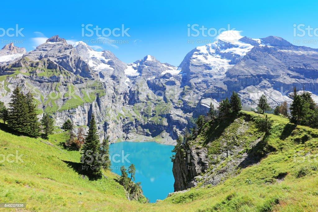Oeschinensee Mountain Lake Panorama Switzerland stock photo