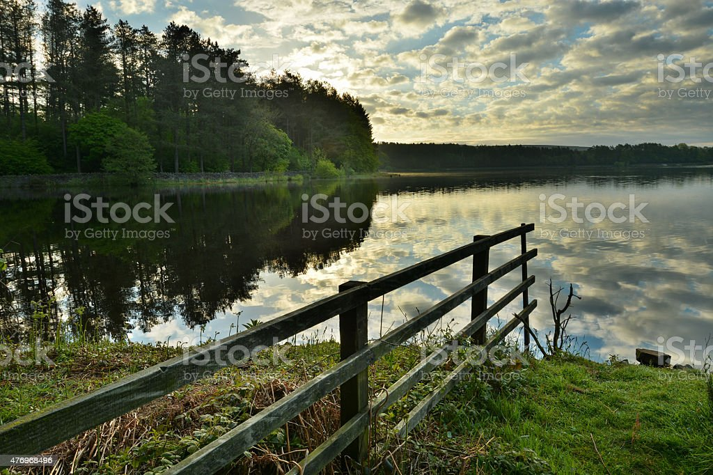 HDR Of A Cloudy Scene At Entwistle Reservoir. stock photo