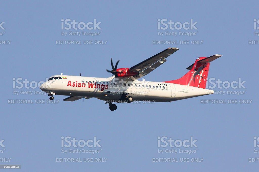 XY-AJQ ATR72-200 of Asian wings. stock photo
