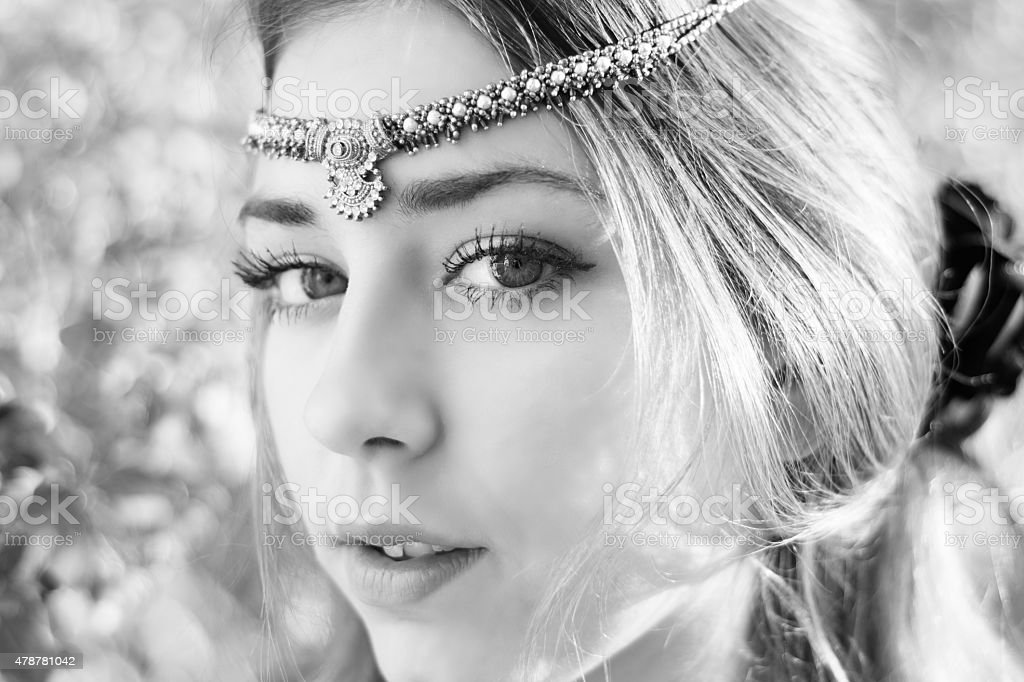 B&W of beautiful teen girl, closeup with head jewelry. stock photo