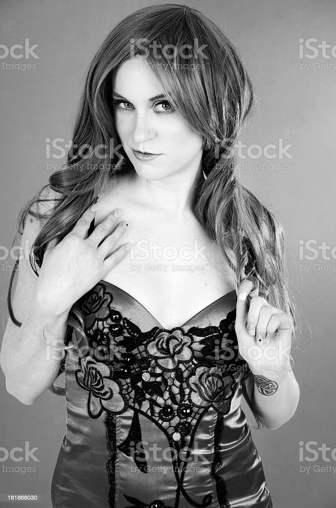 B&W of flirtatious woman in embroidered lingerie. royalty-free stock photo