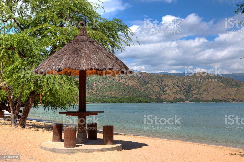 HDR of leaf covered Gazebo on a beach in Dili stock photo