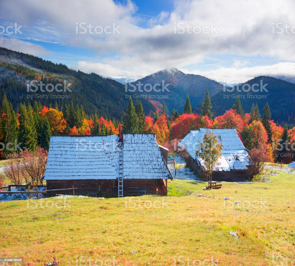 Of mountain farm under the first snow stock photo