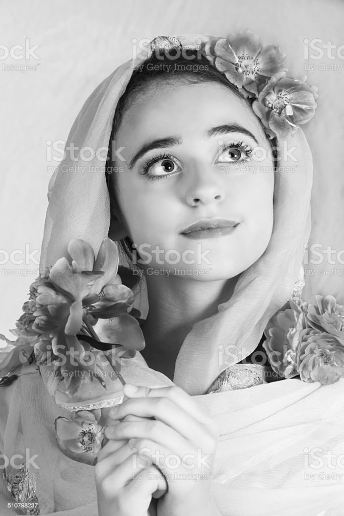B&W of pensive 15 year old in head scarf, stock photo