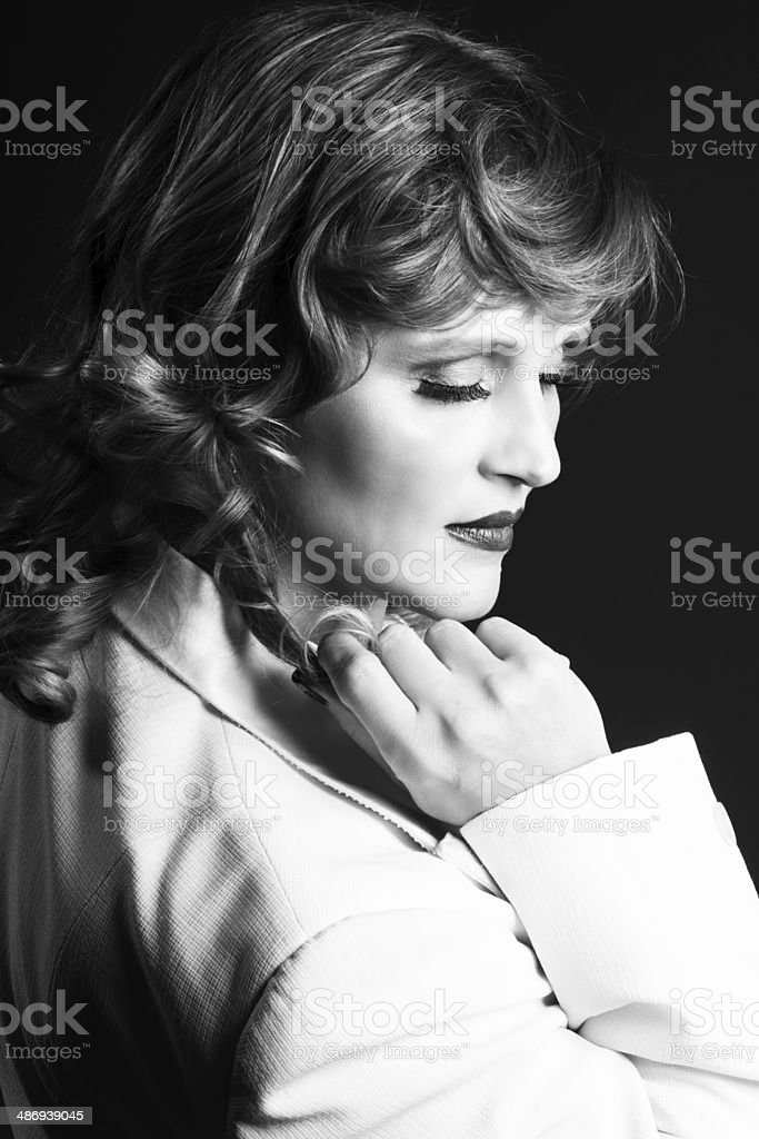 B&W of pensive blonde touching curl, in profile. royalty-free stock photo