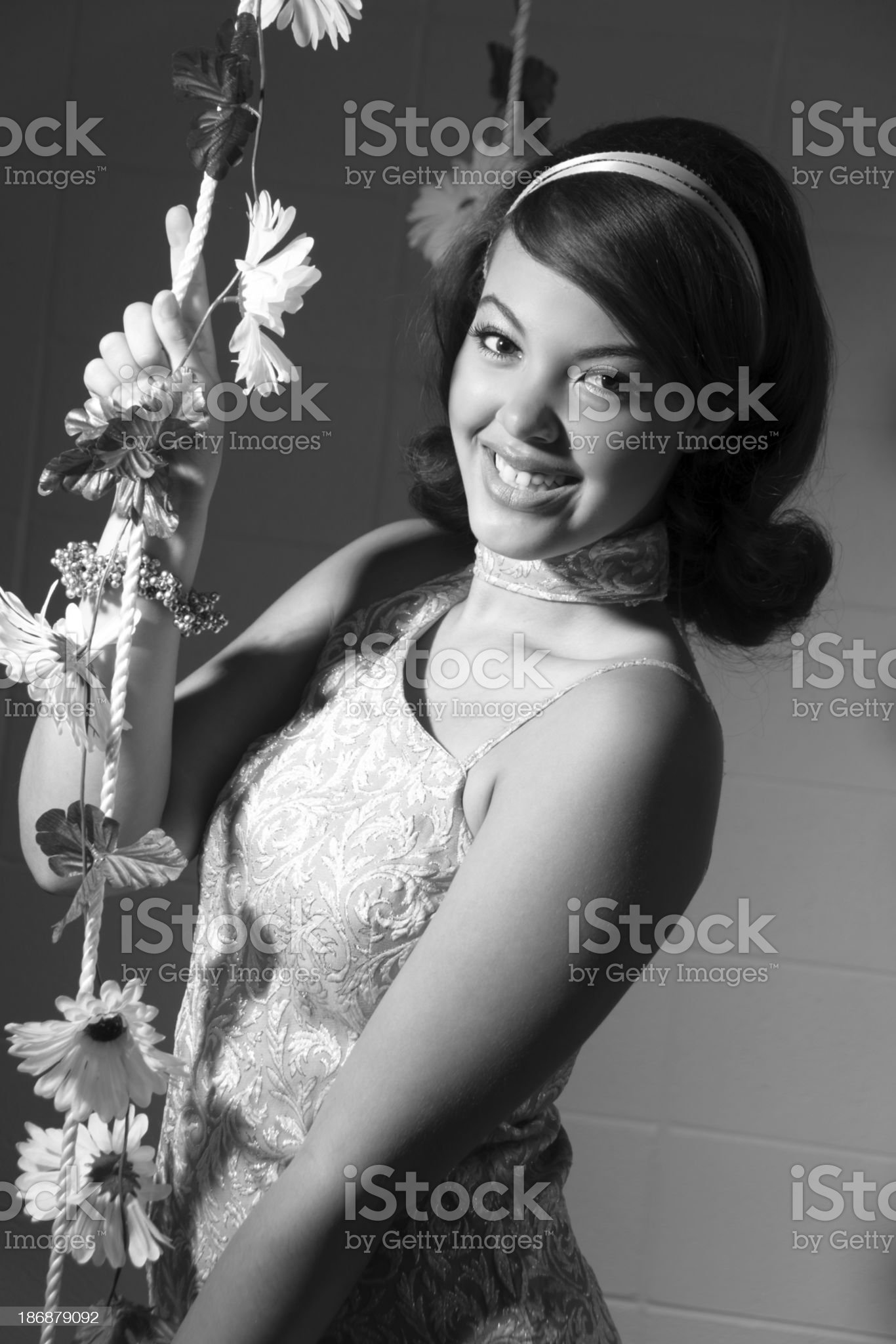 B&W of smiling 60s styled teen with swing. royalty-free stock photo