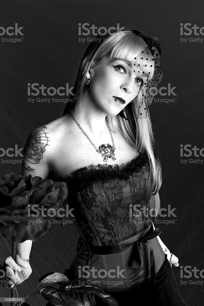 B&W of woman in corset holding big rose. royalty-free stock photo