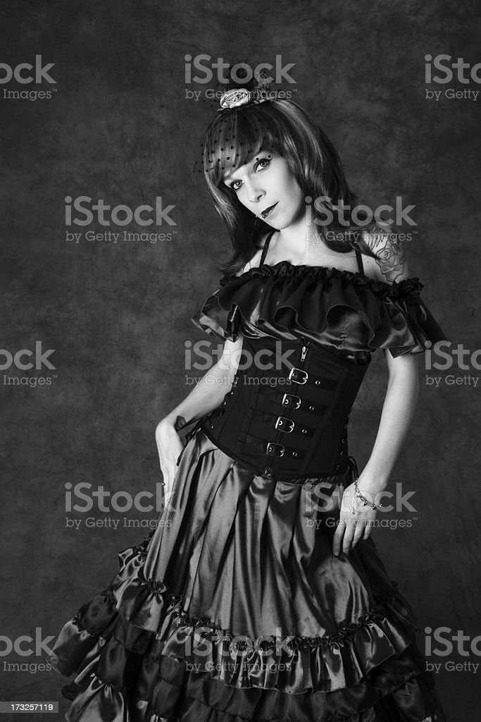 B&W of woman in satin dress and mini hat. royalty-free stock photo
