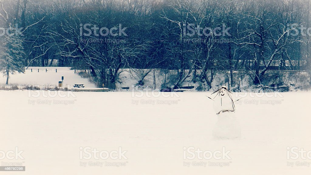 Off Center Tall Snowman on Collins Lake, Scotia, New York stock photo