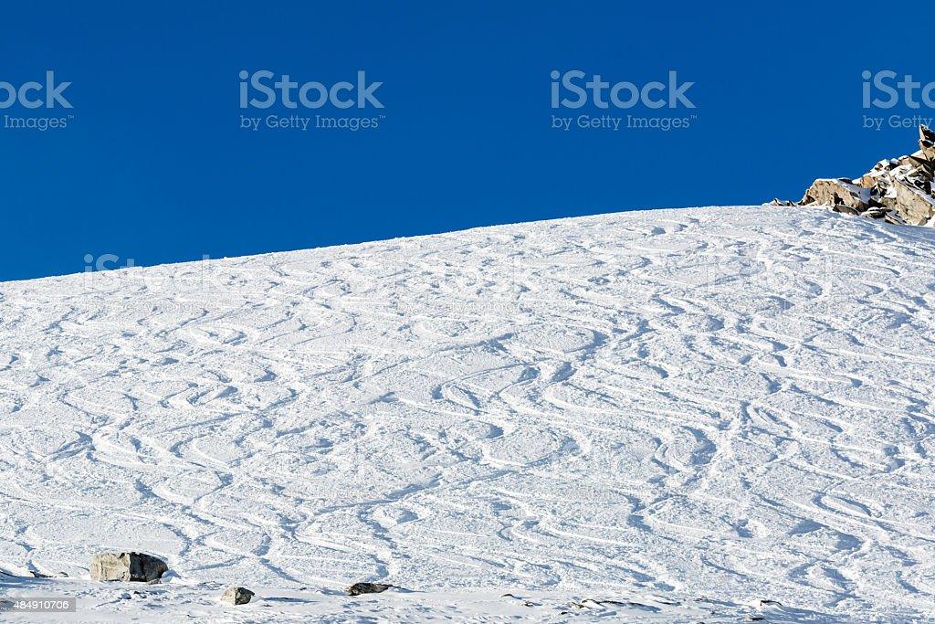 Off piste ski tracks on powder snow stock photo