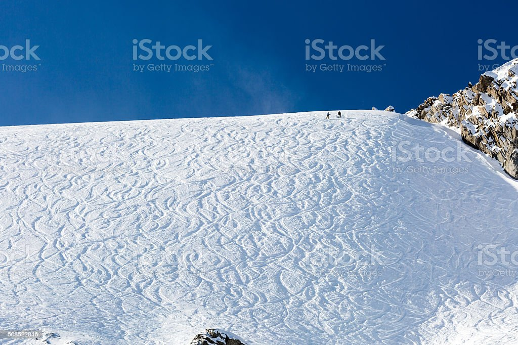 Off piste ski tracks on powder snow stock photo