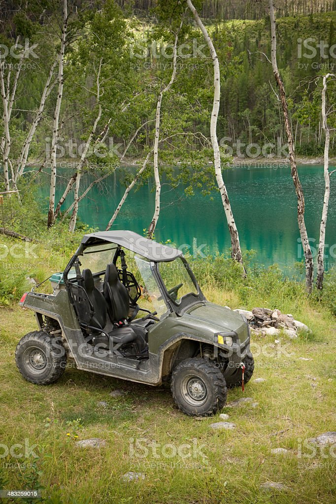 Off road vehicle at mountain lake royalty-free stock photo