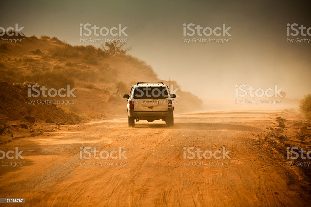Off road vehicle driving along a muddy path royalty-free stock photo
