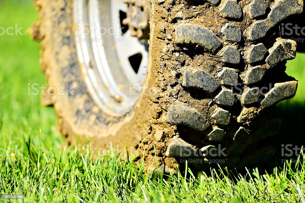 Off road wheel and tire full of mud stock photo
