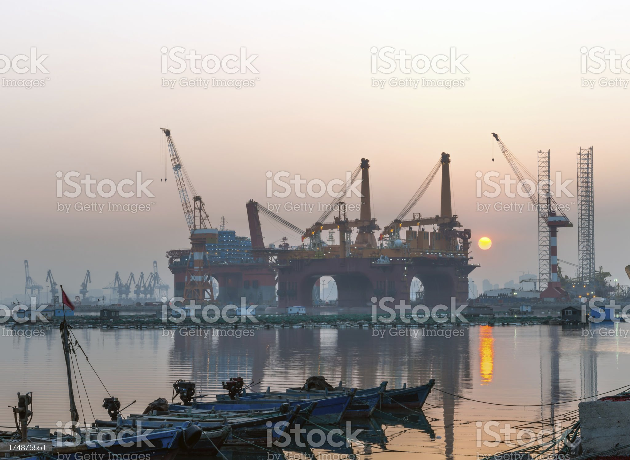 Off shore oil platforms at Sunset royalty-free stock photo