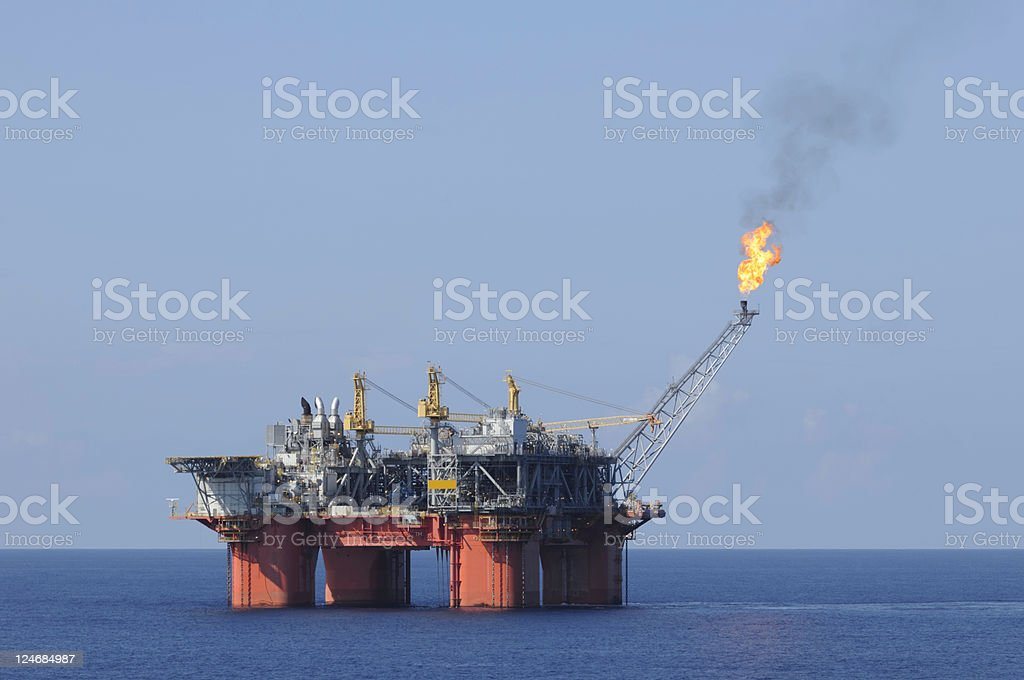 Off shore oil production platform with flare royalty-free stock photo