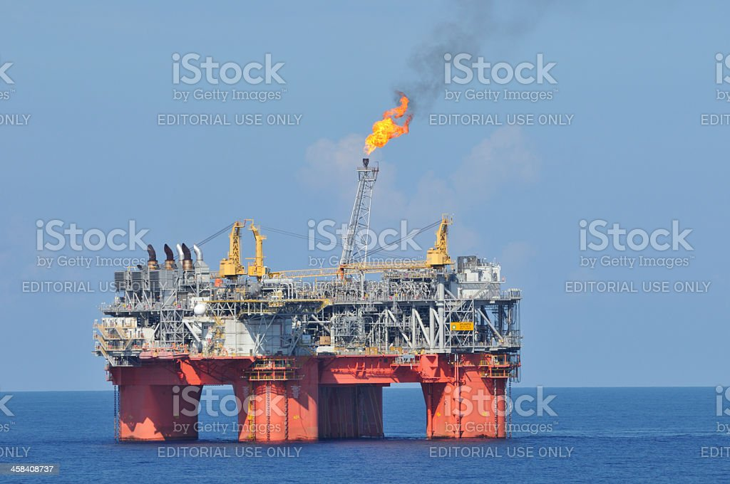 Off shore oil production platform with flare stock photo
