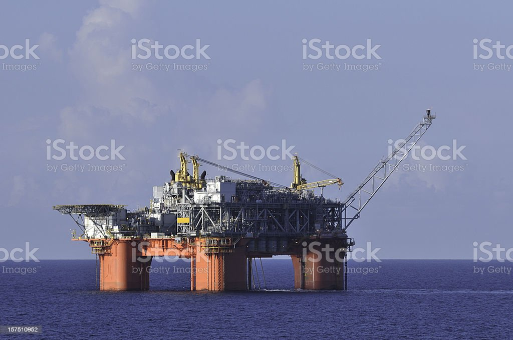 Off shore oil production platform with flare stack royalty-free stock photo