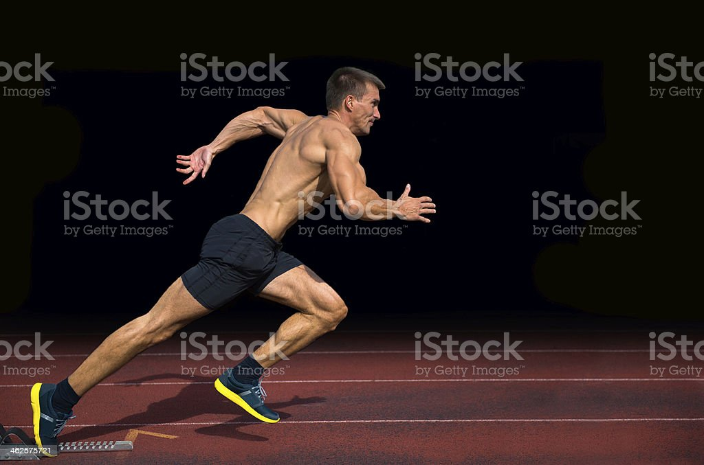 Off the Blocks, Athlete Practicing Start on 100m Sprint stock photo