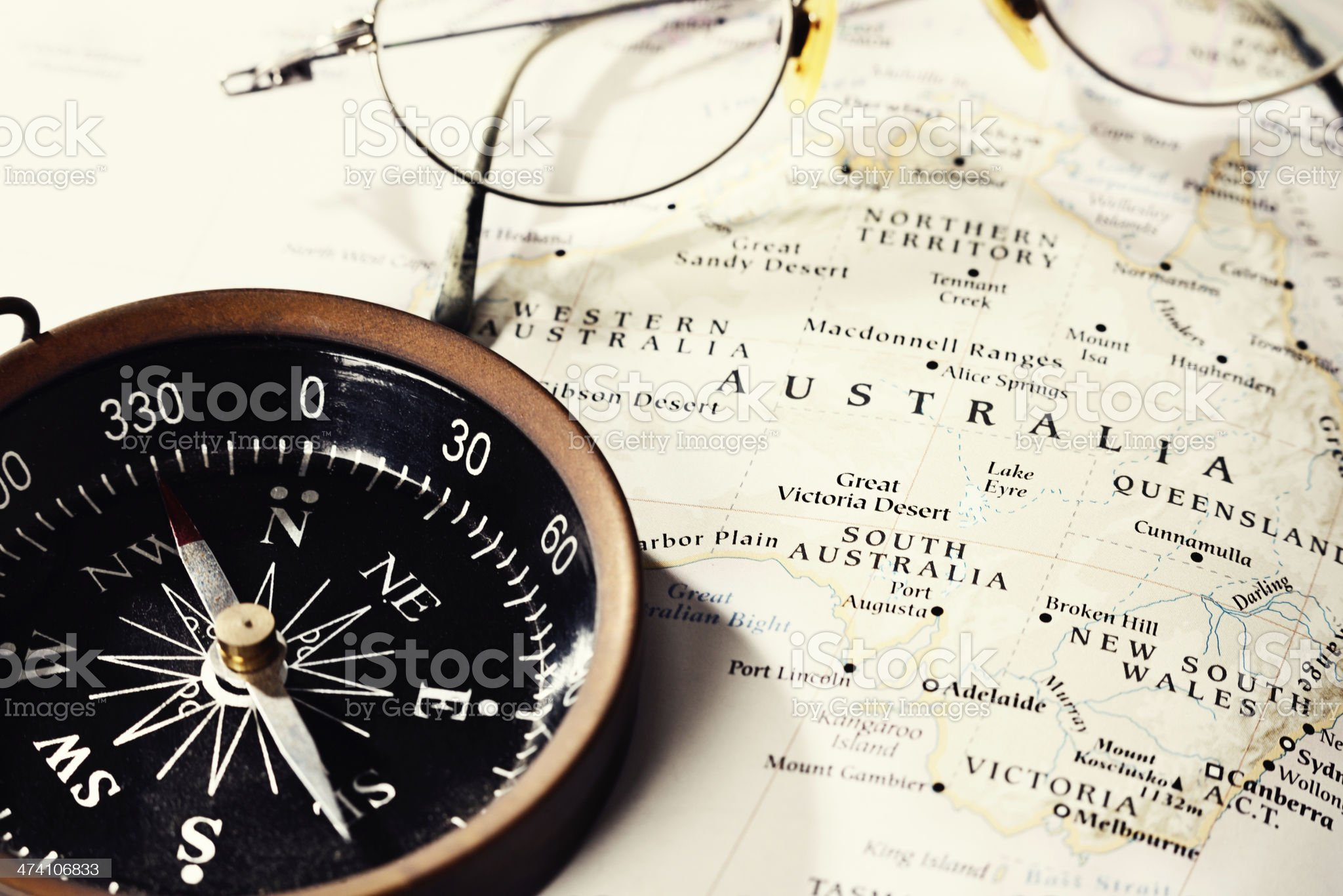 Off to the Outback! Australian map with compass and spectacles royalty-free stock photo