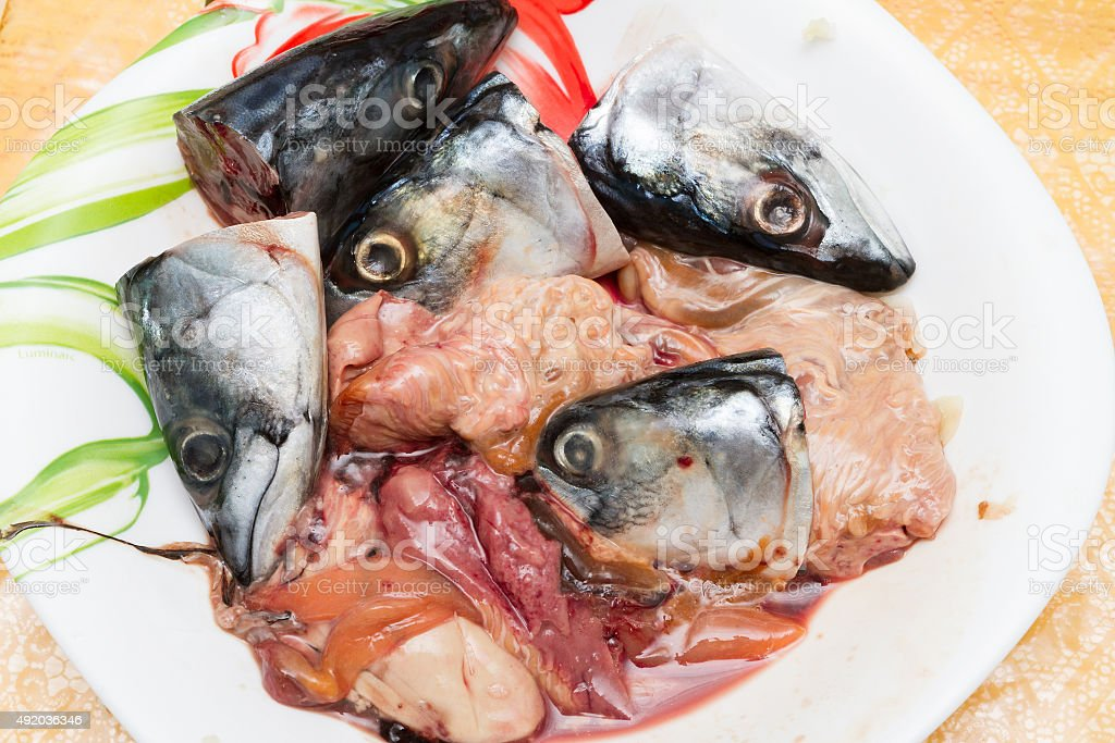 Offal, waste from fish in a plate stock photo