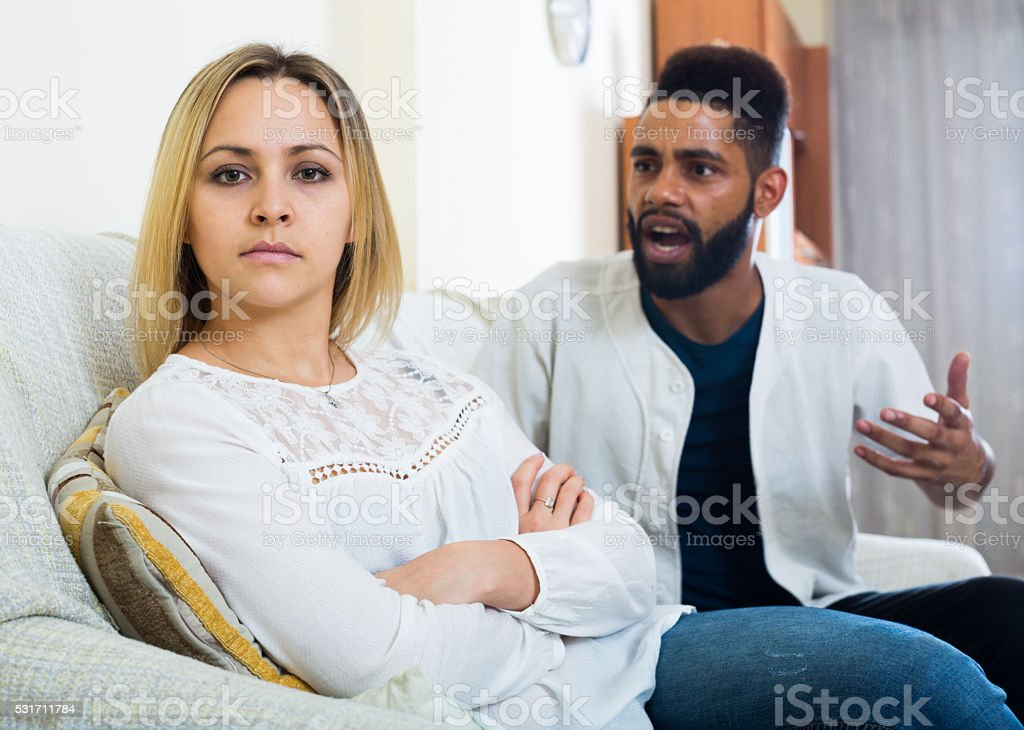 Offended black guy having bad fight with girlfriend and shouting stock photo