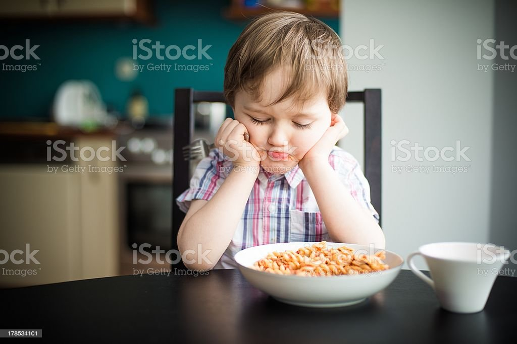 Offended boy at dinner royalty-free stock photo