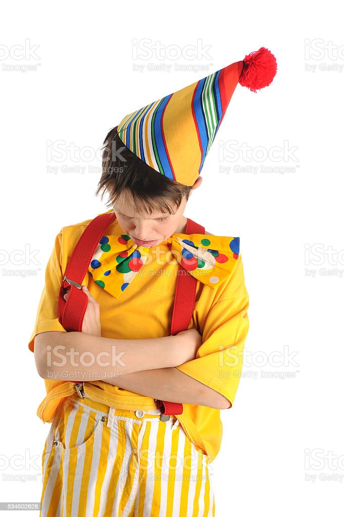 Offended clown boy stock photo