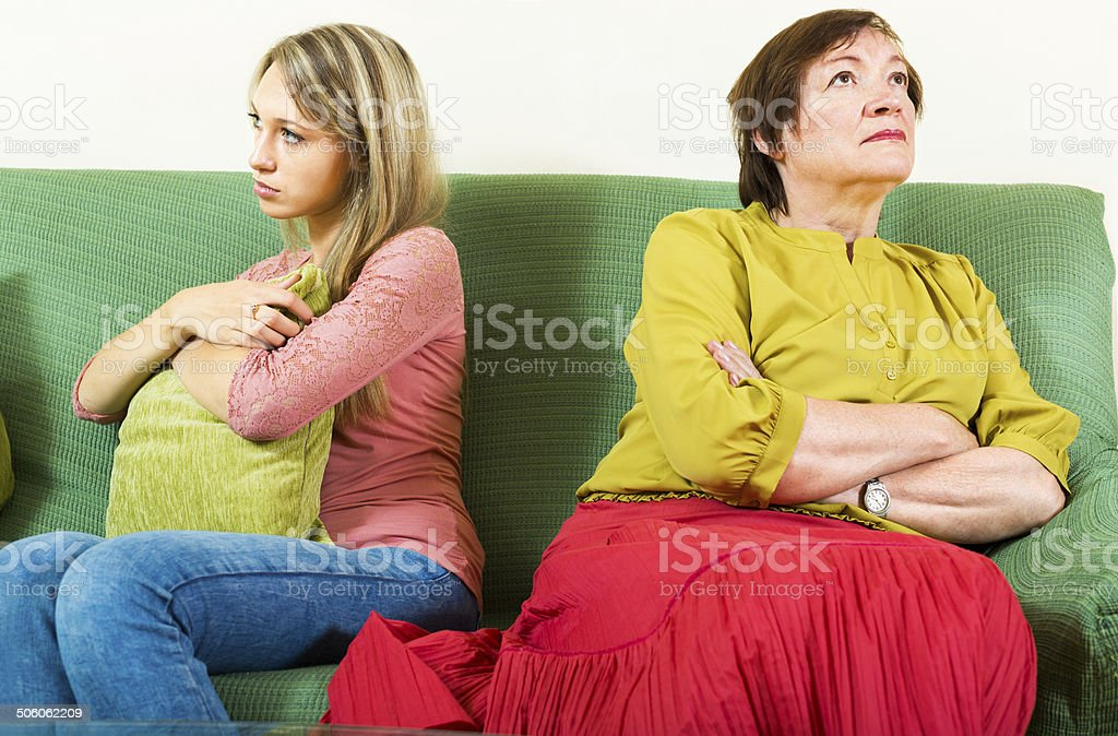 Offended  mother and daughter after a quarrel stock photo