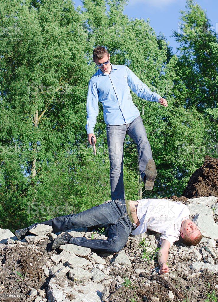 Offender gets rid of the corpse, throws off a cliff royalty-free stock photo